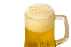 Frosty glass of light beer Stock Images