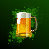 Frosty glass of light beer for St Patrick's Day. In green and black colors Royalty Free Stock Photos