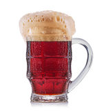 Frosty glass of red beer isolated on a white background Stock Photography