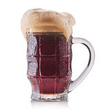 Frosty glass of red beer isolated on a white background Royalty Free Stock Photography
