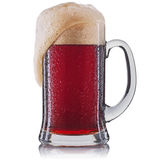 Frosty glass of red beer isolated on a white background royalty free stock image
