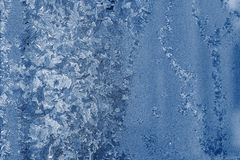 Frosty glass with a silvery blue pattern Royalty Free Stock Photography