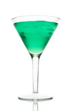 Frosty green martini with ice in a glass. On a white background Stock Photo
