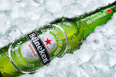 Frosty Heineken Beer Bottle Laying On Ice Cubes  Royalty Free Stock Images