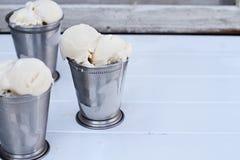 Melting Vanilla Ice Cream in Frosty Cups Stock Photos