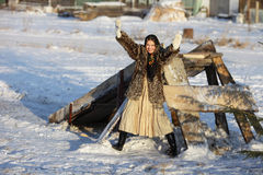 Frosty Morning. Girl in a fur coat and scarf. Winter Village.Canon 5Dmark2 Stock Photography