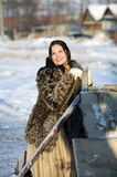 Frosty Morning. Girl in a fur coat and scarf. Winter Village.Canon 5Dmark2 Royalty Free Stock Image