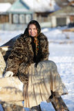 Frosty Morning. Girl in a fur coat and scarf. Winter Village.Canon 5Dmark2 Royalty Free Stock Images