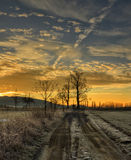 Frosty morning. Alpenglow on the dirt road in front of the Cross Stock Images