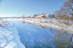 Frosty morning. On the river near the village royalty free stock photo