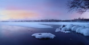 Frosty morning on the lake. Beautiful colors at dawn royalty free stock photo