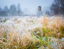 Frosty morning landscape and raised hide. Frosty morning landscape with raised hide. Early winter landscape with meadow and hoarfrost Stock Photo