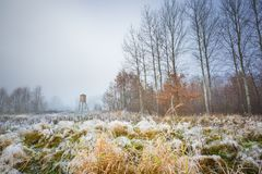 Frosty morning landscape and raised hide. Frosty morning landscape with raised hide. Early winter landscape with meadow and hoarfrost Royalty Free Stock Image