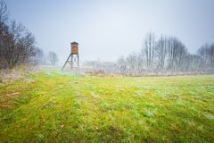 Frosty morning landscape and raised hide. Frosty morning landscape with raised hide. Early winter landscape with meadow and hoarfrost Stock Photography