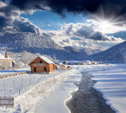 Frosty morning in mountain village. Royalty Free Stock Photo
