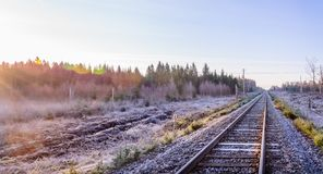 Frosty morning sunrise at the traintracks leading into the unkno Royalty Free Stock Photo
