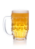 Frosty mug of light beer with foam on white Royalty Free Stock Photo