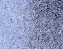 Frosty natural pattern on the window.Frozen patterns on the glass.Winter ice embroidered lace background.Frosted icy texture. Selective focus royalty free stock photos