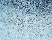 Frosty natural pattern on winter window.Frost patterns on glass. Winter ice embroidered lace on the window Stock Image