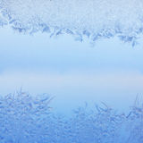 Frosty pattern. On winter window Stock Photos