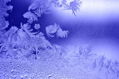 Frosty pattern. Beautiful natural frosty pattern on the window glass in winter time Royalty Free Stock Image