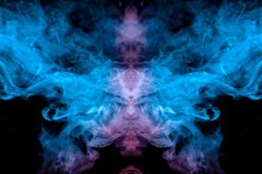Frosty pattern of evaporating vape smoke on a dark background in the form of a ghostly image of a neon blue and head stock photography