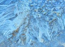 Frosty pattern on a glass stock image