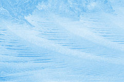 Frosty pattern on glass. Beautiful background with frosty pattern on glass Stock Photo