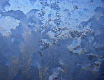 Frosty pattern on glass winter window Stock Photos
