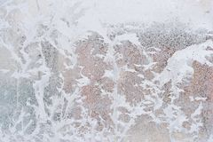 Frosty pattern on glass winter window, look through glass royalty free stock photo