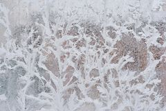 Frosty pattern on glass winter window, look through glass stock images