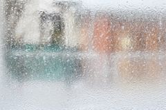 Frosty pattern on glass winter window, look through glass. Cold winter day Royalty Free Stock Photography