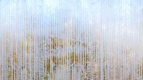 Frosty pattern of hoarfrost and snowflakes on striped glass, winter or Christmas background, texture royalty free stock photography
