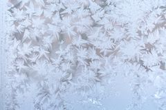Frosty pattern from many pointed snowflakes on window glass. Sel. Christmas background. Beautiful frosty pattern from many pointed snowflakes on window glass Royalty Free Stock Photos