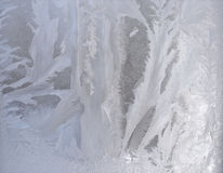 Frosty pattern on pane - silver ice texture Stock Photos