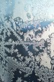 Frosty pattern on the window. At cold winter day Stock Images
