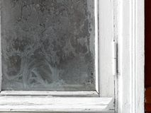 Frosty pattern on the window. A frosty pattern on the window, outdoor cropped closeup Stock Photos