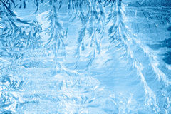 Frosty pattern on window in winter season Stock Images