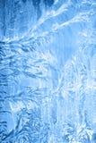 Frosty pattern on window in winter season Royalty Free Stock Photo