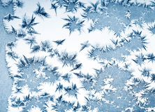 Frosty pattern at a winter window glass stock photo