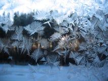 Frosty pattern on winter window Stock Photos