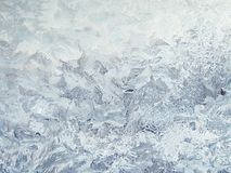 Frosty patterns on the glass. Beautiful natural winter background Royalty Free Stock Photography