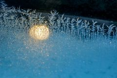 Frosty patterns on the glass of the car. Beautiful frost royalty free stock photos