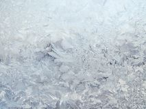 Frosty patterns on the glass. Beautiful natural winter background Royalty Free Stock Images