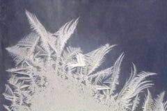 Frosty patterns on the window glass closeup