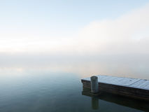 Frosty Pier in Dense Winter Fog Stock Photos