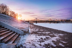Frosty quay. Frosty promenade overlooking the bridge in the evening sunset Royalty Free Stock Photography
