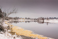 Frosty River Bend. Beautiful reflections on a still river on an early winter day in Northern Finland royalty free stock images