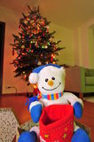 Frosty the snowman. Toy and a Christmas tree stock photography