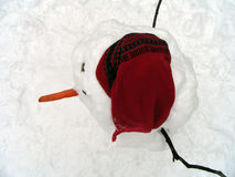 Frosty Snowman. Snowman with red hat and carrot, top-view Stock Photos